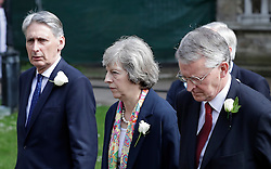 © Licensed to London News Pictures. 20/06/2016. London, UK. PHILIP HAMMOND MP< THERESA MAY MP and HILARY BENN MP arrive at St Margaret's Church, Westminster Abbey to take part in a Service of Prayer and Remembrance to commemorate Jo Cox MP, who was killed in her constituency on June 16, 2016. Photo credit: Peter Macdiarmid/LNP