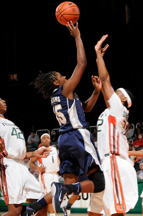 December 7, 2010: Morgan Williams of the Georgetown Hoyas shoots over Morgan Stroman of the Miami Hurricanes during the NCAA basketball game between Georgetown and Miami. The 'Canes defeated the Hoyas 81-72.