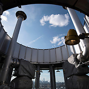 "February 19, 2015 - New York, NY : The downtown Manhattan skyline, punctuated by the spire of One World Trade Center, can be seen from the top of one of Newtown Creek Wastewater Treatment Plant's eight ""egg-shaped"" digesters. The plant, located in Greenpoint, Brooklyn, is the largest of New York City's 14 wastewater treatment plants. Bacteria in the digesters break down sludge (organic material removed from sewage) into water, carbon dioxide, methane, and ""digested sludge."" The city burns the methane to create energy and uses the digested sludge as a fertilizer. CREDIT: Karsten Moran for The New York Times"