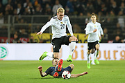 Eric Dier of England tackles Julian Brandt of Germany during the International Friendly match between Germany and England at Signal Iduna Park, Dortmund, Germany on 22 March 2017. Photo by Phil Duncan.