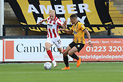 Ryan Broom and Jake Carroll  during the EFL Sky Bet League 2 match between Cambridge United and Cheltenham Town at the Cambs Glass Stadium, Cambridge, England on 25 August 2018.