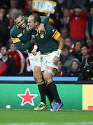 South Africa's Fourie du Preez (Captain) celebrating scoring with South Africa's Bryan Habana during the Rugby World Cup Quarter Final match between South Africa and Wales at Twickenham, Richmond, United Kingdom on 17 October 2015. Photo by Matthew Redman.