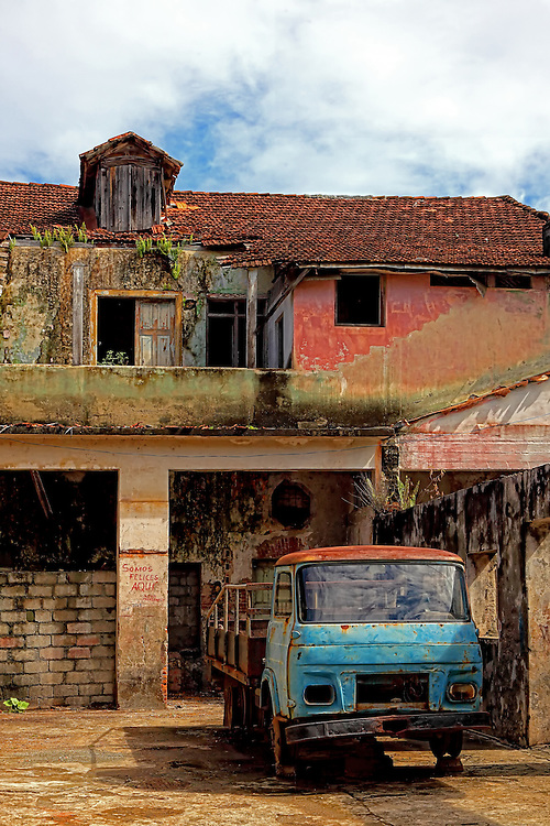 Truck and house in Baracoa, Guantanamo, Cuba.