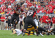 September 01 2012: Northern Illinois Huskies running back Leighton Settle (23) jumps over a defender during the first half of the NCAA football game between the Iowa Hawkeyes and the Northern Illinois Huskies at Soldiers Field in Chicago, Illinois on Saturday September 1, 2012. Iowa defeated Northern Illinois 18-17.