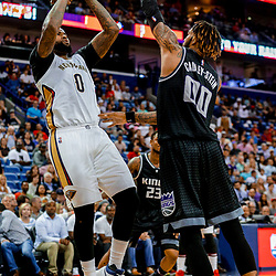 Mar 31, 2017; New Orleans, LA, USA; New Orleans Pelicans forward DeMarcus Cousins (0) shoots over Sacramento Kings center Willie Cauley-Stein (00) during the second half of a game at the Smoothie King Center. The Pelicans defeated the Kings 117-89. Mandatory Credit: Derick E. Hingle-USA TODAY Sports