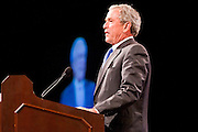 16 MARCH 2011 - PHOENIX, AZ:  Former President George W. Bush speaks at Arizona Christian University's 50th anniversary dinner at the Phoenix Convention Center Wednesday night. Hundreds of people from progressive and social justice groups demonstrated against the former president in front of the Convention Center. More than 1200 people paid $500 each to hear the former President.    PHOTO BY JACK KURTZ