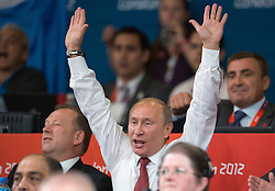 Russian President Vladimir Putin cheering  Gold medal winner Tagir Khaibulaev at the  Judo at the London 2012 Olympics , Thursday 2nd August 2012  Photo by: i-Images