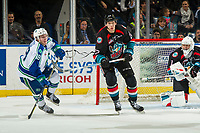 KELOWNA, CANADA - OCTOBER 23:  Braydyn Chizen #22 of the Kelowna Rockets stick checks Ethan Regnier #18 of the Swift Current Broncos on October 23, 2018 at Prospera Place in Kelowna, British Columbia, Canada.  (Photo by Marissa Baecker/Shoot the Breeze)