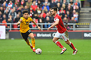 Bailey Wright (5) of Bristol City is closed down by Morgan Gibbs-White (17) of Wolverhampton Wanderers during the The FA Cup 5th round match between Bristol City and Wolverhampton Wanderers at Ashton Gate, Bristol, England on 17 February 2019.