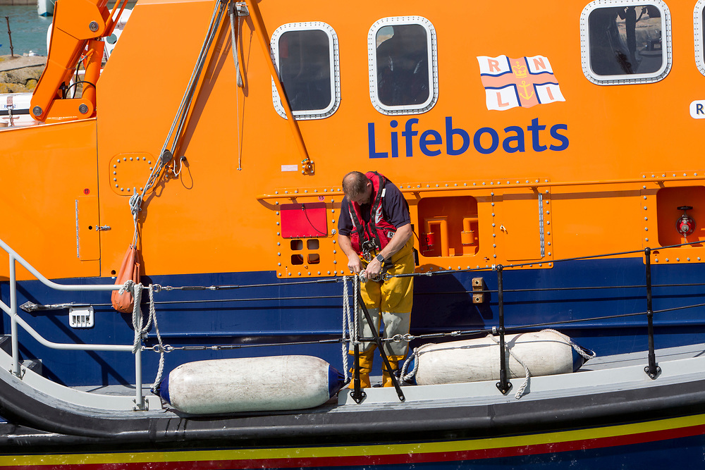 A crew member scecures a buoy to the Royal National Lifeboat Institution RNLI Dover Life boat (17-09) leaving  Folkestone Harbour, Folkestone, Kent. UK. (photo by Andrew Aitchison / In pictures via Getty Images)
