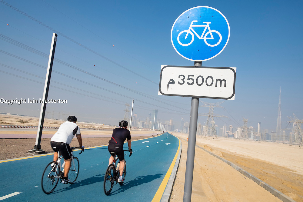 Cyclists on new cycle track at District One at new property development in Dubai United Arab Emirates