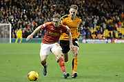 Nottingham Forest midfielder Ben Osborn and Wolverhampton Wanderers midfielder Dave Edwards tussle during the Sky Bet Championship match between Wolverhampton Wanderers and Nottingham Forest at Molineux, Wolverhampton, England on 11 December 2015. Photo by Alan Franklin.
