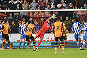 Hull City defender Isaac Hayden (20) takes shot at goal saved by Brighton goalkeeper, Niki Maenpaa (1) during the The FA Cup match between Hull City and Brighton and Hove Albion at the KC Stadium, Kingston upon Hull, England on 9 January 2016. Photo by Ian Lyall.