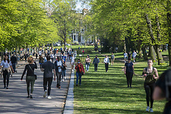 People enjoy the sun at Victoria Park, East area of London, UK on April 19, 2020, despite the lockdown due the spread of Covid-19. Photo by Dezonne Erica/ABACAPRESS.COM