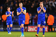 Leicester City forward Jamie Vardy (9) and Leicester City defender Christian Fuchs (28) applaud the Leicester supporters during the Champions League quarter final match 2 between Leicester City and Atletico Madrid at the King Power Stadium, Leicester, England on 18 April 2017. Photo by Jon Hobley.