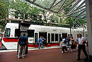 Image of the Max light rail picking up passengers in downtown Portland, Oregon, Pacific Northwest