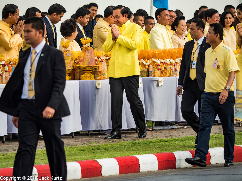 09 JUNE 2016 - BANGKOK, THAILAND: General PRAYUT CHAN-O-CHA, the Prime Minister of Thailand, greets members of his cabinet as he arrives at the Grand Palace for a special merit making ceremony in honor of Bhumibol Adulyadej, the King of Thailand. Thailand marked 70 years of the reign of Bhumibol Adulyadej with a special alms giving ceremony for 770 monks in front of the Grand Palace in Bangkok. The King, also known as Rama IX, ascended the throne on 9 June 1946. He is the longest serving monarch in Thai history and the longest serving monarch in the world today. He is revered by most Thais and is widely seen as a unifying figure in the country.     PHOTO BY JACK KURTZ