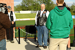 14 May 2016: members of the Rolling Thunder dedicate an unoccupied chair with respect to all American MPO's and MIA's during a Frontier League Baseball game between the Joliet Slammers and the Normal CornBelters at Corn Crib Stadium on the campus of Heartland Community College in Normal Illinois