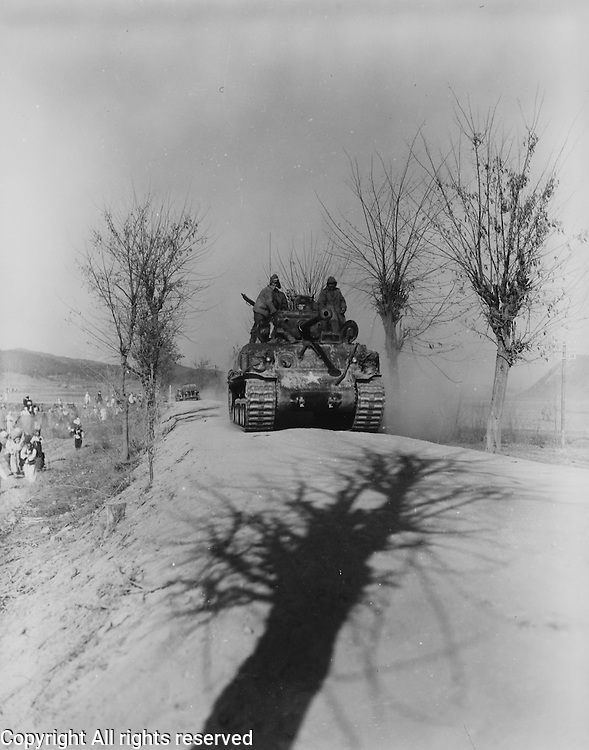 U.N. Army tanks fall back from an area south of Sunchon, Korea for regrouping.