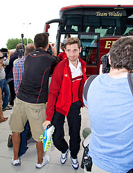 NEWPORT, WALES - Monday, August 12, 2013: Wales' Joe Allen squeezes past photographers as he arrives for training at the FAW National Development Centre at Dragon Park ahead of the International friendly against the Republic of Ireland. (Pic by David Rawcliffe/Propaganda)