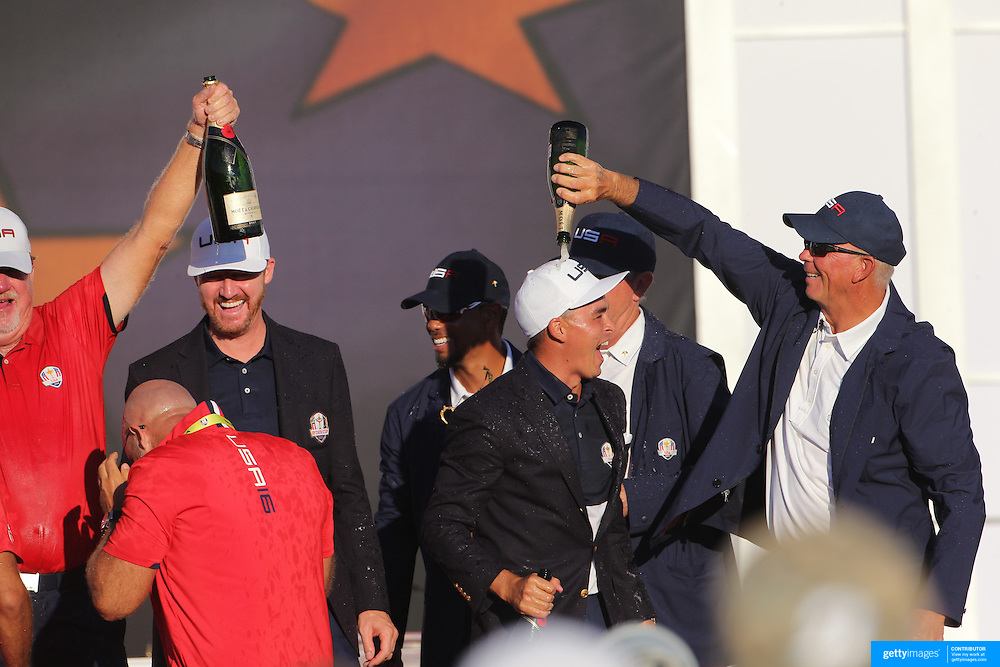 Ryder Cup 2016. Day Three. Rickie Fowler celebrates as he covered with champagne after the United States victory in the Ryder Cup tournament at Hazeltine National Golf Club on October 02, 2016 in Chaska, Minnesota.  (Photo by Tim Clayton/Corbis via Getty Images)