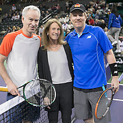March 1, 2014, Indian Wells, California: <br /> John McEnroe, Jim Courier, and Barbara Tolman, wife of Esurance CEO Gary Tolman, take part in a ceremonial coin toss in Stadium 2 at the Indian Wells Tennis Garden before the McEnroe Challenge for Charity presented by Esurance.<br /> (Photo by Billie Weiss/BNP Paribas Open)