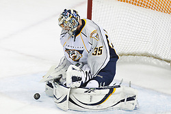 January 8, 2011; San Jose, CA, USA; Nashville Predators goalie Pekka Rinne (35) saves a shot against the San Jose Sharks during the first period at HP Pavilion. Nashville defeated San Jose 2-1. Mandatory Credit: Jason O. Watson / US PRESSWIRE