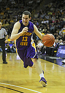 December 07 2010: Northern Iowa Panthers guard Johnny Moran (13) drives to the basket during the first half of their NCAA basketball game at Carver-Hawkeye Arena in Iowa City, Iowa on December 7, 2010. Iowa defeated Northern Iowa 51-39.