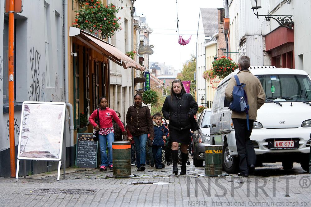 BRUSSELS - BELGIUM - 21 OCTOBER 2008 -- School children and adult on the move in Marollen district in Brussels. Photo: Erik Luntang/INSPIRIT Photo