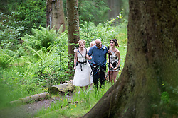 Martin Milner and Colette Gregory tying the knot in the trees at Go Ape Aberfoyle. Colette and the father of the bride Simon Gregory arriving.