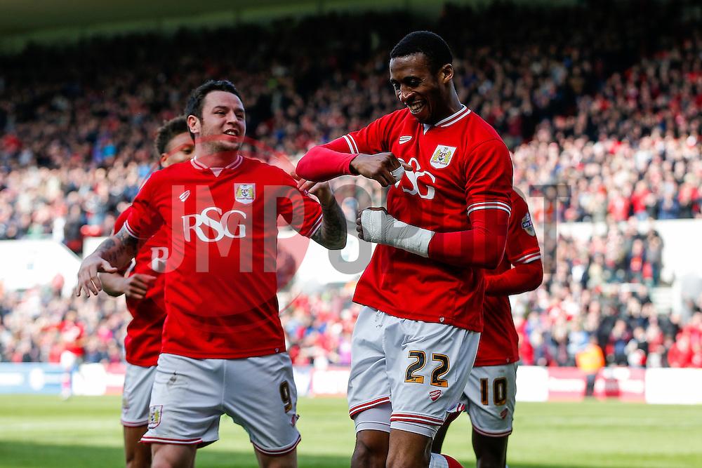 Jonathan Kodjia of Bristol City celebrates scoring a goal to make it 3-0 - Mandatory byline: Rogan Thomson/JMP - 30/04/2016 - FOOTBALL - Ashton Gate Stadium - Bristol, England - Bristol City v Huddersfield Town - Sky Bet Championship.