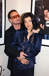 BONO and his wife ALI HEWSON at a party to launch the One T-Shirt by Edun held at Harvey Nichols, Knightsbridge, London on 18th October 2006.<br />