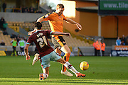 Burnley midfielder George Boyd tackles Wolverhampton Wanderers midfielder Kevin McDonald during the Sky Bet Championship match between Wolverhampton Wanderers and Burnley at Molineux, Wolverhampton, England on 7 November 2015. Photo by Alan Franklin.