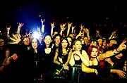 Crowd leaning on barrier and front of rock gig.<br /> 1999