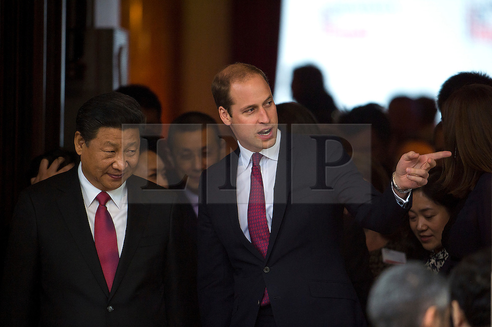 © Licensed to London News Pictures. 21/10/2015. London, UK. Chinese president  XI JINPING leaving the event with PRINCE WILLIAM. CATHERINE, Duchess of Cambridge, and PRINCE WILLIAM, Duke of Cambridge accompanied Chinese president  XI JINPING and his wife PENG LIYUAN as they attend Creative Collaborations event at Lancaster House in London, as part of the Chinese state visit to the uk. The couples were shown a new Aston Martin DB10 from the Spectre James bond film and new London Bus and taxi transports.  Photo credit: Ben Cawthra/LNP