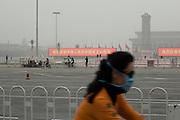 Chang'an avenue, September 30 afternoon. Tiananmen square has been closed to public in order to prepare the celebration of the 1st october. Near the portrait of Sun Yat-sen specially displayed , two slogan say: &quot;Let's celebrate warmly the 60 years of the foundation of the People's Republic of China !&quot;. In the background the Mao's mausoleum and the Revolution heroes monument.<br /> <br /> Merdredi 30 apr&egrave;s-midi: quelques cyclistes passent sur l'avenue Chang'an (Paix Eternelle) o&ugrave; va se d&eacute;rouler le d&eacute;fil&eacute; militaire. Au fond la place Tiananmen a &eacute;t&eacute; ferm&eacute;e au public depuis le matin pour pr&eacute;parer le spectacle comm&eacute;morant la naissance de la R&eacute;publique populaire de Chine ce jeudi 1er octobre. Le portrait de Sun Yat-sen a &eacute;t&eacute; instal&eacute; pr&egrave;s du monument aux h&eacute;ros du peuple et du mausol&eacute;e de mao (&agrave; l'arri&egrave;re plan). Des panneaux lumineux ont &eacute;t&eacute; install&eacute;es disant &quot;C&eacute;l&eacute;brons chaleureusement les 60 ans de la fondation de la R&eacute;publique populaire de Chine !&quot;.