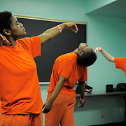 "From left, inmates Demetrius Carroll, Erica Jones, Tasha Anderson and Marisabela Sarria dance during a ""ecstatic"" dance class by teacher Sylvie Minot at the San Francisco County Jail on July 17, 2014 in San Francisco, CA. Sylvie Minot leads dance classes inside the SF County Jail to help bring inmates inner peace. Minot also leads classes for the public in Marin, and for vets at the VA clinic."