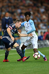 December 17, 2016 - Melbourne, Victoria, Australia - LEIGH BROXHAM (6) of the Victory and BRUCE KAMAU (11) of Melbourne City compete for the ball in the round 11 match of the A-League between Melbourne City and Melbourne Victory at AAMI Park, Melbourne, Australia. Victory won 2-1 (Credit Image: © Sydney Low via ZUMA Wire)