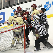 Members of the Northeastern Huskies and Boston College Eagles fight on the ice during The Beanpot Championship Game at TD Garden on February 10, 2014 in Boston, Massachusetts. (Photo by Elan Kawesch)
