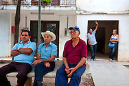 Men on bench in Bocas, Holguin, Cuba.