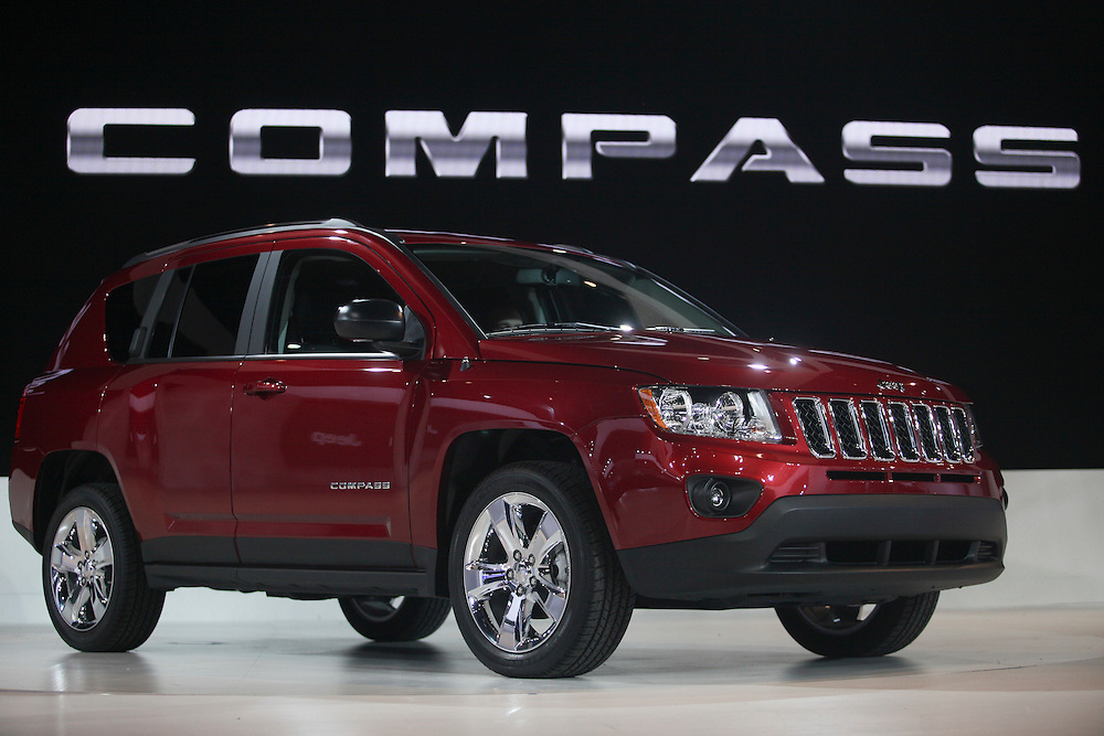 GR --- Detroit, Michigan ---11-01-10--- The restyled 2011 Jeep Compass is unveiled during the company's press conference at the North American International Auto Show in Detroit, Michigan January 10, 2011.<br /> Geoff Robins AFP