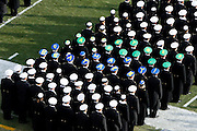 "6 Dec 2008: Navy Midshipman wear ""Go Army, Beat Navy"" hats on the field before the Army / Navy game December 6th, 2008. At Lincoln Financial Field in Philadelphia, Pennsylvania."