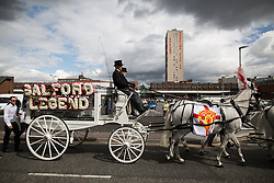 "© Licensed to London News Pictures . 28/08/2015 . Salford , UK . The procession passes along Heywood Way  . The funeral of Paul Massey at St Paul's CE Church in Salford . Massey , known as Salford's "" Mr Big "" , was shot dead at his home in Salford last month . Photo credit : Joel Goodman/LNP"