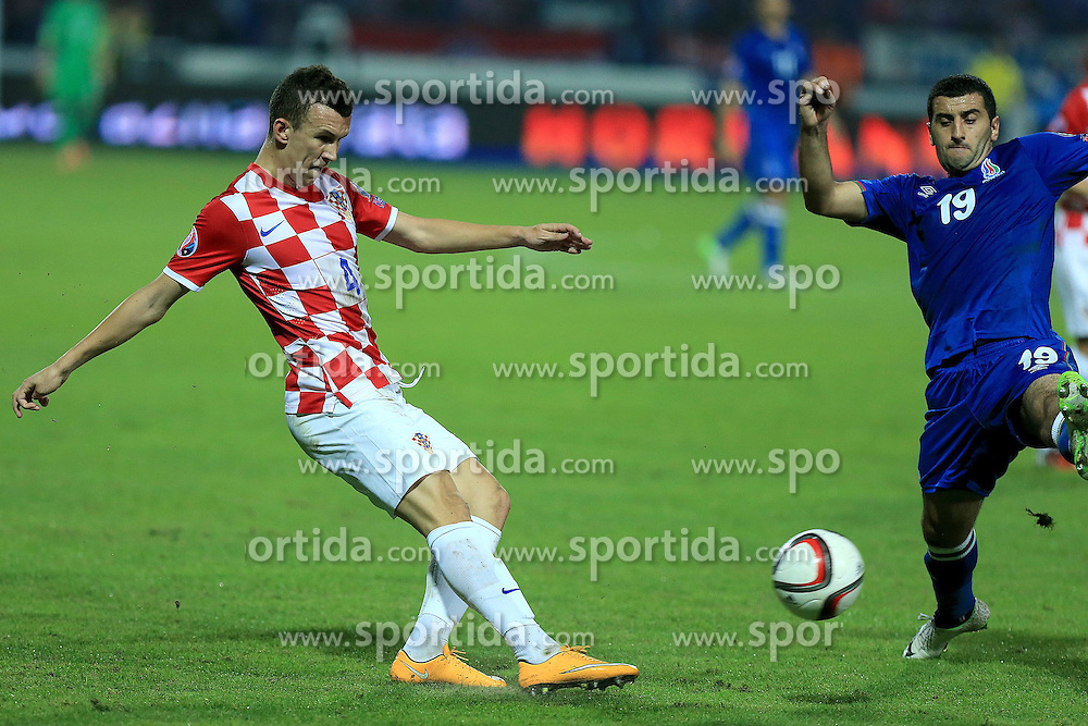 13.10.2014, Stadion Gradski vrt, Osijek, CRO, UEFA Euro Qualifikation, Kroatien vs Aserbaidschan, Gruppe H, im Bild Ivan Perisic, Rahid Amirguliyev // during the UEFA EURO 2016 Qualifier group H match between Croatia and Azerbaijan at the Stadion Gradski vrt in Osijek, Croatia on 2014/10/13. EXPA Pictures &copy; 2014, PhotoCredit: EXPA/ Pixsell/ Davor Javorovic<br /> <br /> *****ATTENTION - for AUT, SLO, SUI, SWE, ITA, FRA only*****