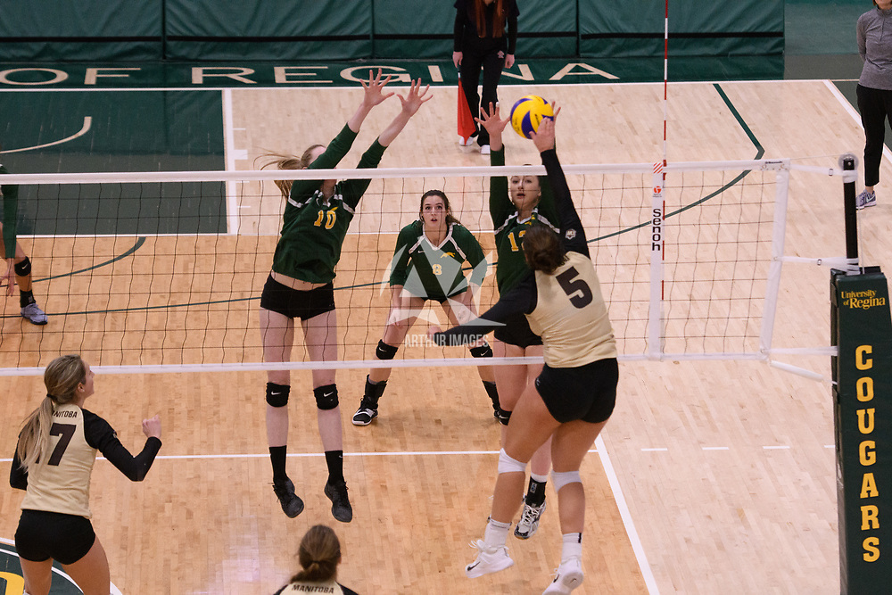 4th year middle blocker Kathleen Ens (8) of the Regina Cougars in action during Women's Volleyball home game on February 10 at Centre for Kinesiology, Health and Sport. Credit: Arthur Ward/Arthur Images