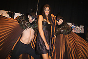 Lisa Maree Show, Australian Fashion Week, Sydney. .Models getting ready backstage for Lisa Maree show..Lisa Maree with models backstage.