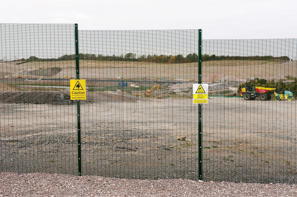 """© Licensed to London News Pictures. 19/10/2015. Hinkley Point, Somerset, UK.  View of preparations at the site of the proposed new nuclear power station Hinkley C, next to the existing Hinkley Point nuclear site. Anti-nuclear protest by the """"Osborne's Folly"""" (after the Chancellor George Osborne) group, protesting against the proposed new nuclear power station Hinkley C and against Chinese investment in the project.  The group has occupied a roundabout near the site and erected an inflatable white elephant with a banner written in Chinese and say they want to send a message to the visiting Chinese President Xi Jinping that EDF's Hinkley C would be """"a bad investment"""" for the Chinese state. They say that the stalled project has become """"Osborne's Energy Folly"""" and should now be abandoned.  Theo Simon, one of the campaigners said: """"""""Ironically, the Chinese are leading the world in renewable energy investment in their own country, where there is also a growing anti-nuclear movement"""". Photo credit : Simon Chapman/LNP"""