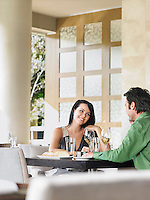Couple talking over wine at outdoor restaurant