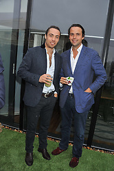 Left to right, JAMES MIDDLETON and CHARLIE GILKES at Inception Group's Hamptons Garden Party to celebrate their collaboration with Embassy Gardens 2016 held at the Ballymore Marketing Suite, Nine Elms Lane, London on 12th July 2012.