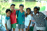 Interracial friends age 12  together at a day camp in Loring Park.  Minneapolis  Minnesota USA